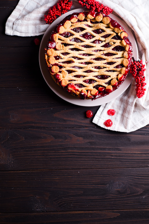 Homemade cherry pie on rustic wooden background, flat lay copy space Stock Photo