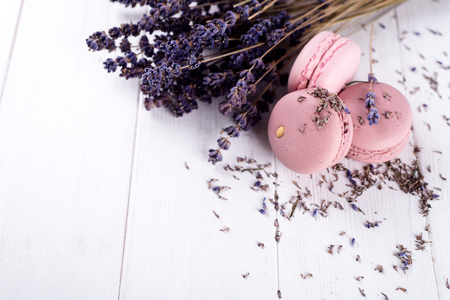 lavender coloured: sweet lavender macaroons French with flowers lavender on white wooden background, copy space Stock Photo