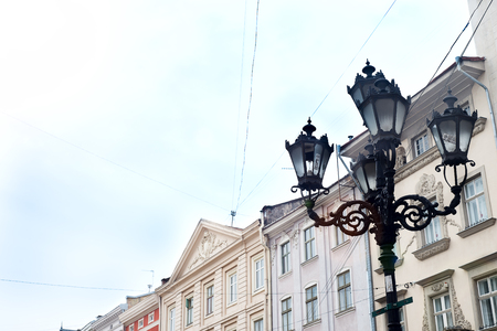 Old street lamp on the background of the house