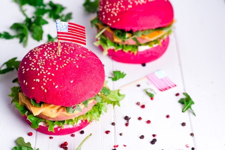 American grilled hamburger with USA flag. 4th of July. Independence day. Stock Photo