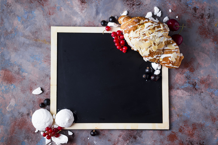 buttered: Croissant with meringue on chalkboard