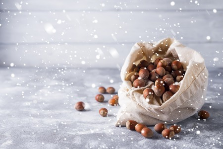 Hazelnuts in a bag Stock Photo