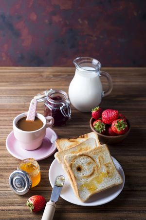 Breakfast with coffee, toasts, strawberry and jam Stock Photo