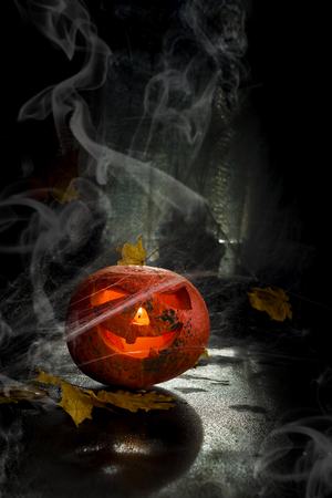 Halloween pumpkin head with spiderweb. Scary evil face spooky holiday. Helloween part. Helloween attributes. copy space Stock Photo