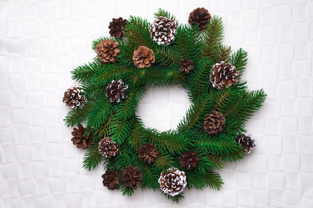 Christmas wreath, isolated on white knitting background, copy space flat lay