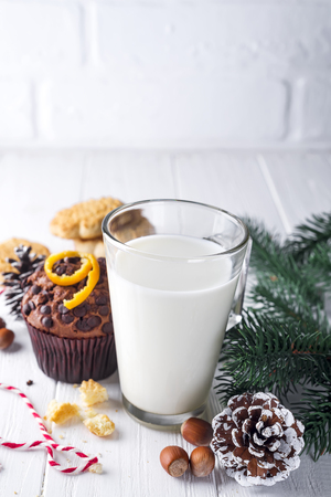 Cookie with milk, muffin, cookies and christmas tree on the table for Santa Claus, copy space Stock Photo