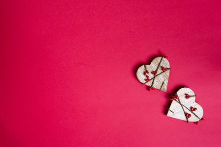 Decorative wooden hearts on red background.Two Valentine hearts. Saint Valentine's Day or Love concept. 스톡 콘텐츠