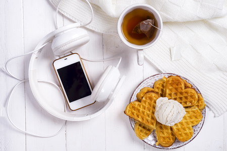 Morning breakfast with waffles and tea in bed