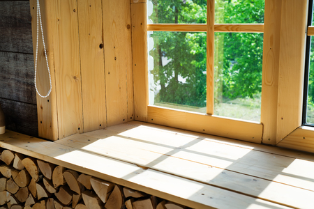 Empty room, wooden window with shadow is projected on the wooden sill Standard-Bild