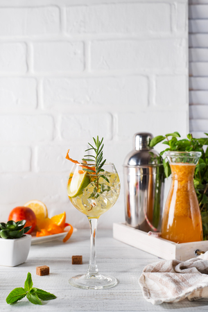 Fresh mojito drink with rosemary, lemon and orange on white wooden backgorund, copy space Stock Photo - 101426822
