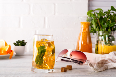 beautiful frozen cocktail glass with ice, mint and ginger on a white wooden backgorund, copy space Stock Photo