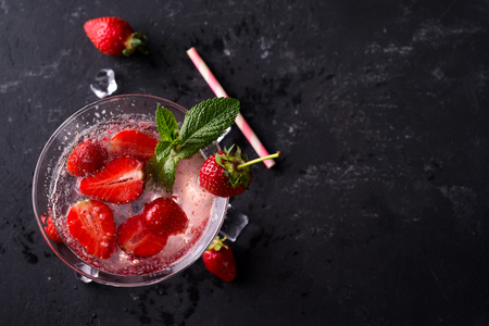 Cocktail strawberry margarita on the slate dark background, copy space. Flat lay