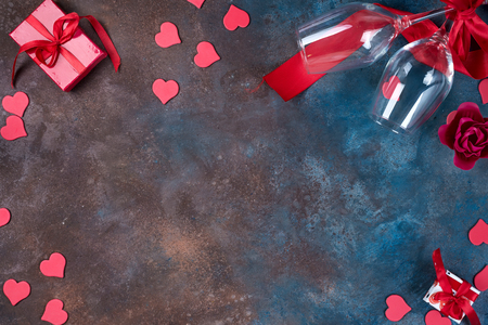 Valentines day background with handmaded hearts, glasses and gift box on a stone background. Valentines Day
