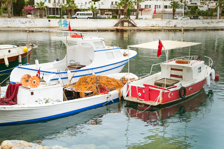 A fishing boat on the Aegean Sea, moored to the shore, Turgutreis Turkey