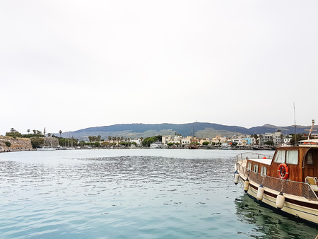 The scenic port with traditional fishing boats in the village , Kos island, Greece