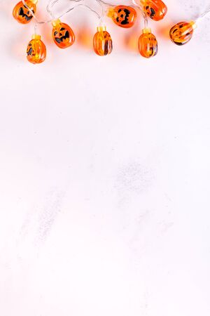 Halloween pumpkin background party lamps on white murble backgrounds,copy space,
