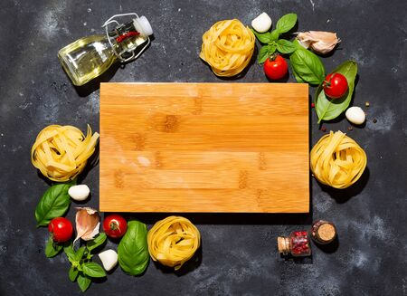 Fresh homemade pasta ingredients on a stone table top view , copy space Imagens