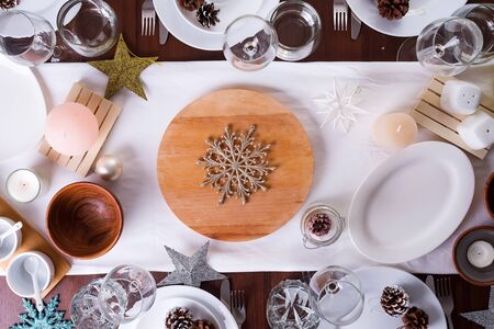 Christmas table setting plate and decoration on dark wooden table, flat lay Фото со стока