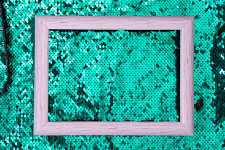White frame on a sequins green glitter wave  texture, copy space