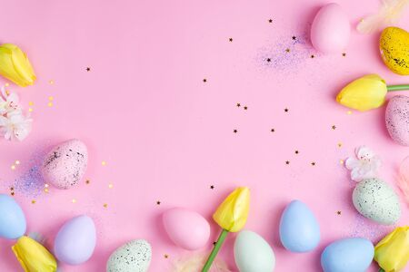 Easter Eggs with tulips on pink stars background. Easter background or easter concept.