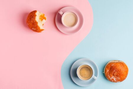 Breakfast backdrop with two cups of coffee and homemade freshly baked doughnuts on a duotone pastel pink blue Zdjęcie Seryjne