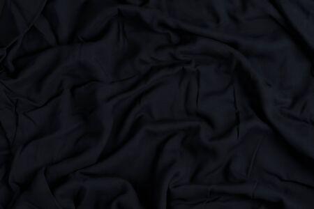 black textil background, copy space. Top view. Congratulation card.