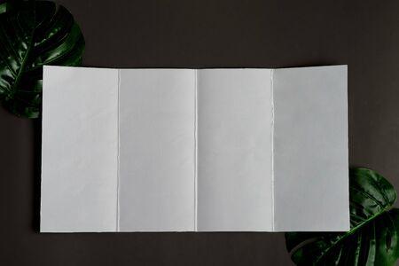 Four-fold brochure mockup above black background Standard-Bild