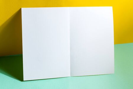 Minimal Folded bifold business white card mockup for writing letter or message above black background with shadows, copy space. Top view. Standard-Bild - 150453364