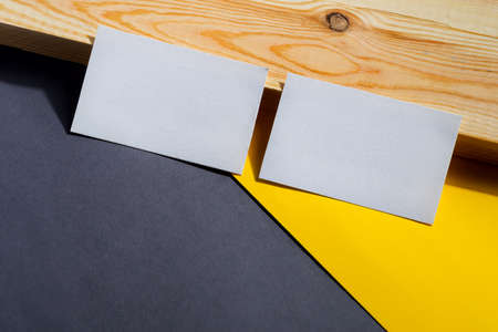 blank business cards on duotone and wooden background, good for texte and logo