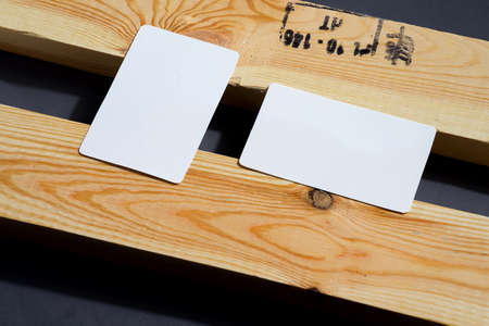 blank business cards on black and wooden background, good for texte and logo Standard-Bild