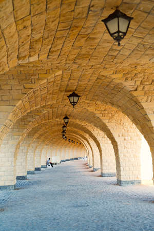 Architectural perspective from arched corridor.