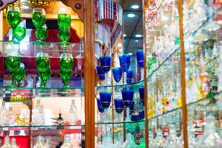 Shop showcase with handmade colorful wine glasses.