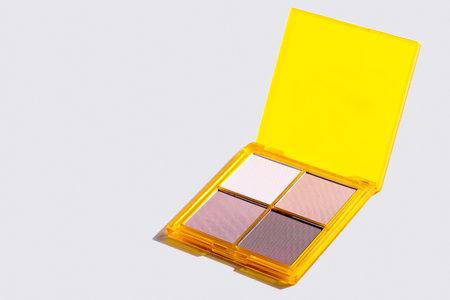 Eyeshadow palette on grey background, eye shadows cosmetics product . Fashion blog design.
