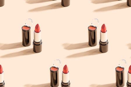 Red lipstick on beige background. Seamless pattern.