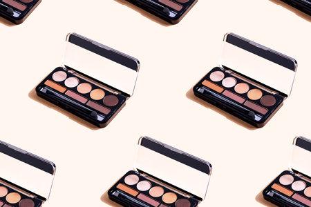 Eyeshadow palette on beige background, eye shadows cosmetics product . Seamless pattern.