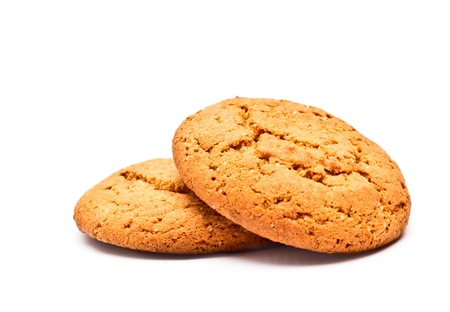 two oatmeal cookies isolated on a white background photo