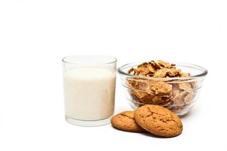 Cereals, oatmeal cookies and yogurt in a glass on a white background photo
