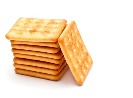 Many crackers pile isolate on a white background photo