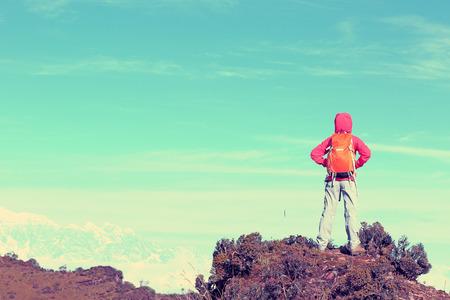jokul: young woman hiker hiking on mountain peak