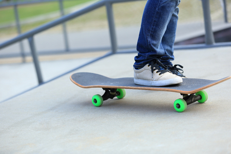 skateboard shoes: skateboarding legs at skatepark Stock Photo
