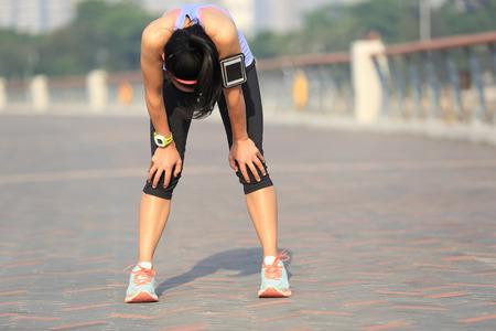 sunshine: tired woman runner taking a rest after running hard on sunshine seaside