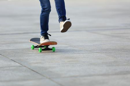 skateboard: skateboarder skateboarding at  city Stock Photo