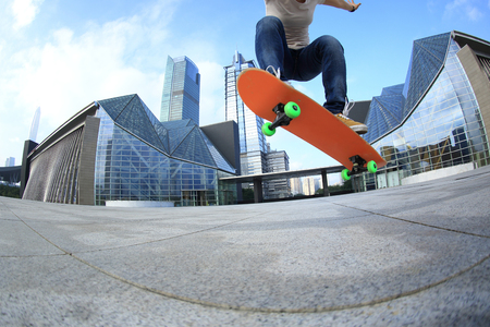 skateboard: skateboarder skateboarding at  city Stock Photo