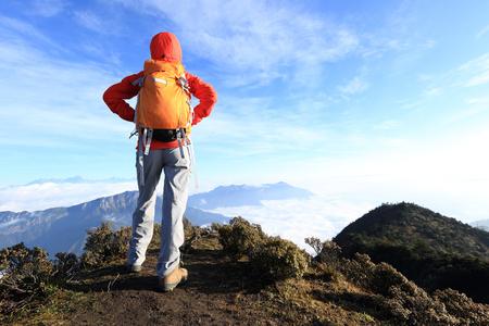 jokul: young woman hiker on mountain peak