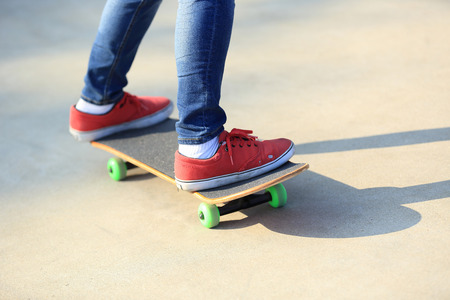 skateboard shoes: skateboarding legs riding on a skateboard