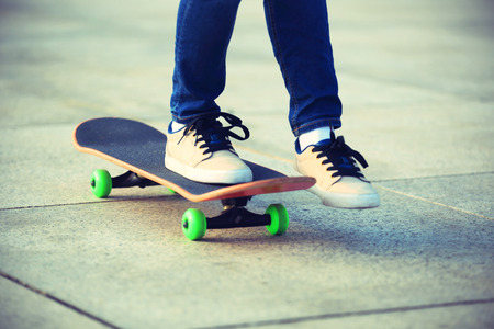 skateboard: skateboarder skateboarding at city