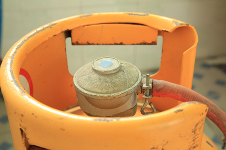 liquefied: Yellow gas cylinder Stock Photo