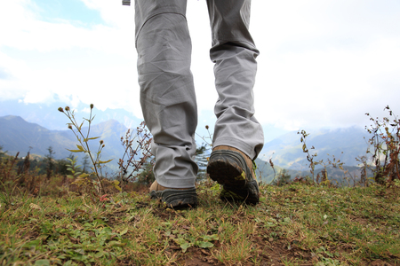 hiking boots: hiking legs on mountain peak