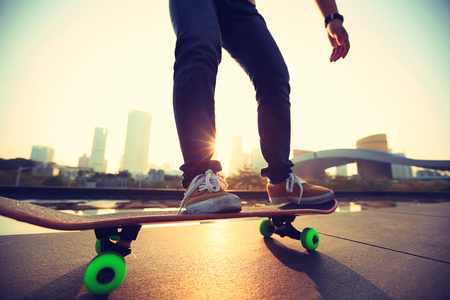 skateboard: skateboarder skateboarding at sunrise city Stock Photo