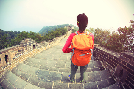 sky: woman hiker hiking  on chinese great wall Stock Photo